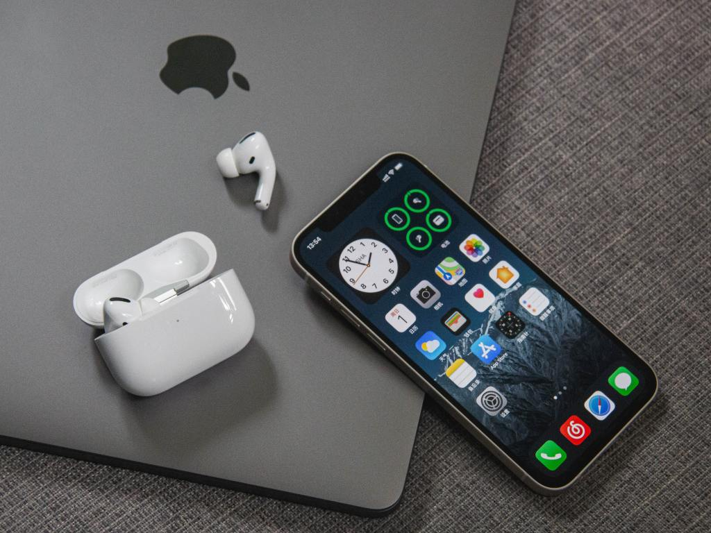 Photo of iPhone and AirPods on top of a MacBook